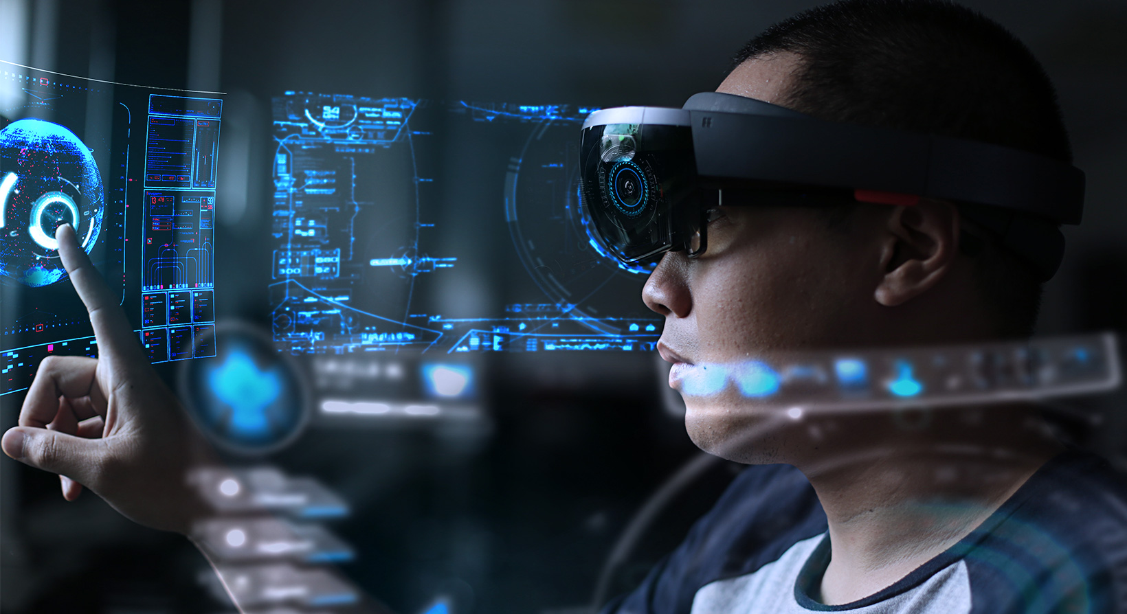 young man using hololens for visualizing data with augmented reality