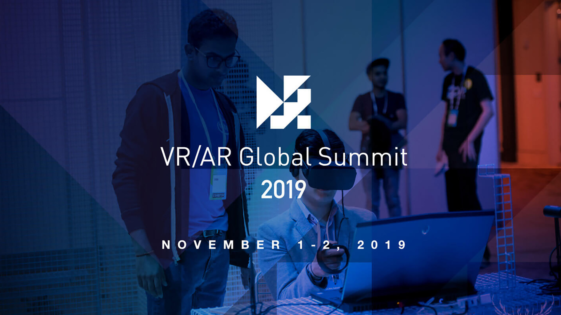 VR AR Global Summit 2019 Banner showing a person in front of computer using virtual reality